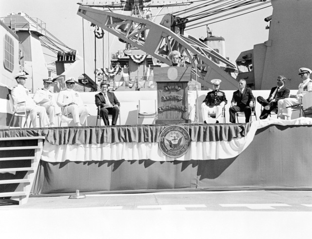 Representative Helen D. Bentley, Republican-Maryland, ship's sponsor, speaks during the commissioning of the dock ship USS FORT MCHENRY (LSD 43).  Distinguished guests seated on the speakers platform are, left to right:  Captain (CAPT) J. Graham, USN, Chaplain, CAPT P. Grasser, Rear Admiral (RDML) (lower half) J.P. Reason, commander, Naval Base, Seattle; P.A. Schneider, Naval Sea Systems Command; Major General (MGEN) C.E. Mundy Jr., US Marine Corps (USMC); Retired Colonel (COL) E.E. Shoults, USMC; J.R. Santosuosso, president, Lockheed Shipbuilding Co.; Commander (CDR) G.S. Rhodes, commanding officer, USS FORT MCHENRY (LSD 43)