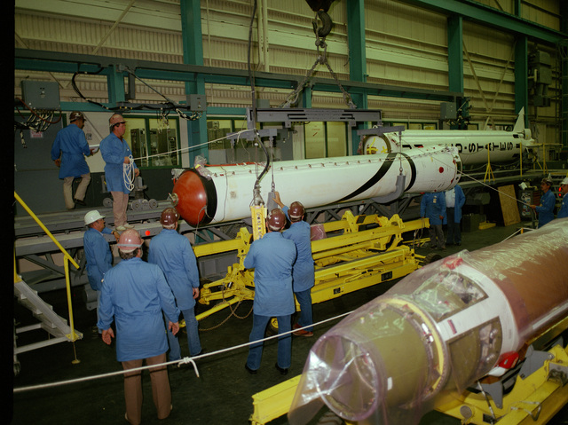 The first and second stages of a Scout rocket are assembled by technicians in Building 960