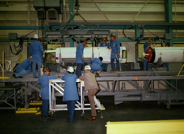 The second and third stages of a Scout rocket are assembled by technicians in Building 960