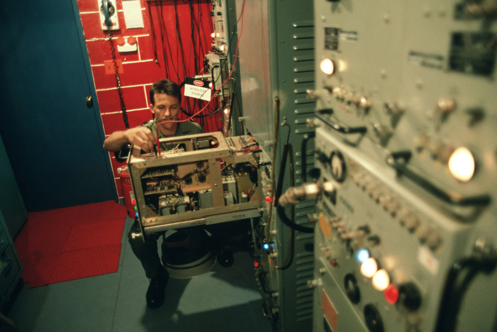 Sergeant (SGT) James Williams, a member of the 1961st Communications Group, checks the power supply voltage and transmitter output pulse count of the tactical air navigation system.  The 1961st recently won the Major General Harold M. McClelland Award for communications excellence for the third time in five years
