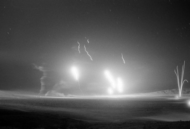 Tracers and explosions illuminate the night sky during a live fire demonstration for family members at the National Training Center