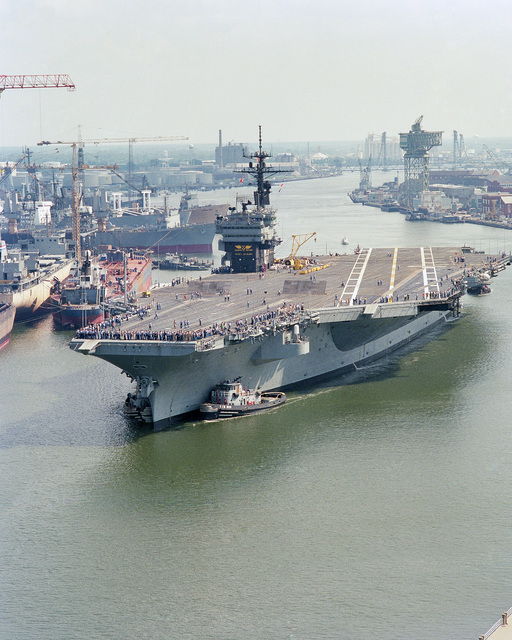 A port bow view of the US Navy (USN) Aircraft Carrier USS JOHN F. KENNEDY (CV 67) leaving the Norfolk Naval Shipyard