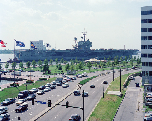 A starboard quarter view of the US Navy (USN) Aircraft Carrier USS JOHN F. KENNEDY (CV 67) on its way to the Norfolk Naval Operating Base from the Norfolk Naval Shipyard.  The Downtown Waterside is in the foreground