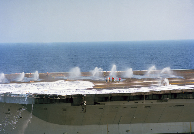 The aqueous film-forming foam (AFFF) system is tested on the forward half of the flight deck of the aircraft carrier USS JOHN F. KENNEDY (CV 67) during sea trails