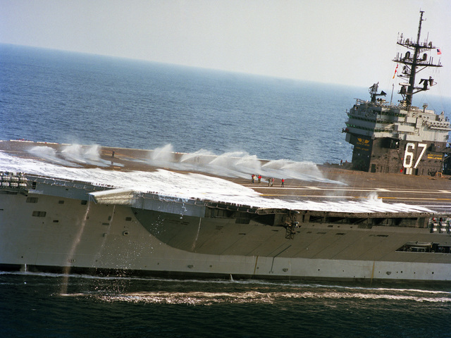 The aqueous film-forming foam (AFFF) system is tested on the forward section of the flight deck of the aircraft carrier USS JOHN F. KENNEDY (CV 67) during sea trails