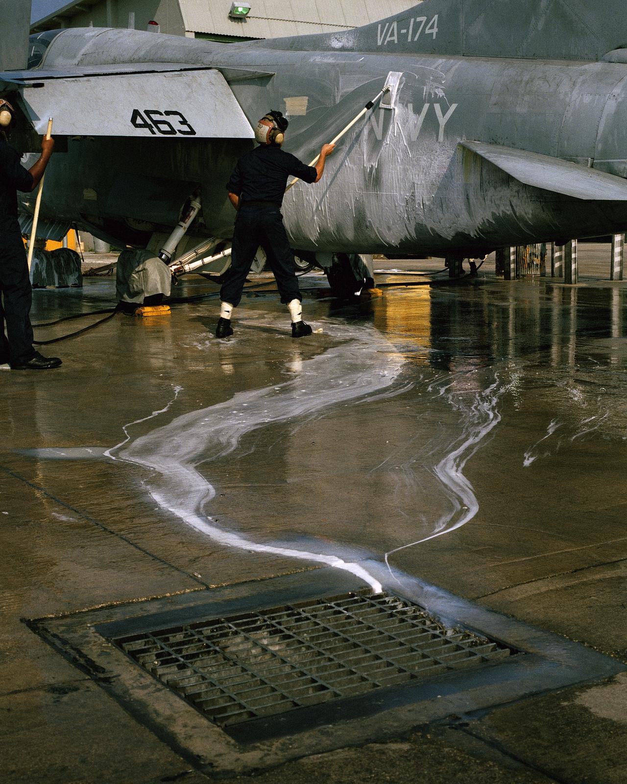 A reservist AIRMAN washes down an Attack Squadron 174 (VA-174) A-7 Corsair II aircraft during his drill weekend at Cecil Field