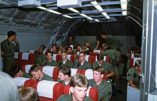 Air Force personnel are seated aboard a KC-10A Extender aircraft in preparation for deployment to Ramstein Air Base, West Germany, for participation in the short-term tactical deployment Exercise CRESTED CAP 87.  Four hundred Air Force personnel and 24 F-
