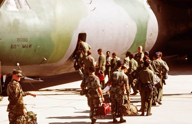 Air Force personnel board a C-141B Starlifter aircraft for deployment to Ramstein Air Base, West Germany, for participation in the short-term tactical deployment Exercise CRESTED CAP 87.  Four hundred Air Force personnel and 24 F-16 Fighting Falcon aircra