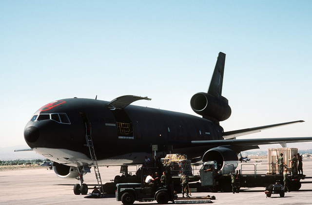 Flight line personnel load cargo pallets aboard a KC-10A Extender aircraft in preparation for deployment to Ramstein Air Base, West Germany, during the short-term tactical deployment Exercise Crested Cap '87