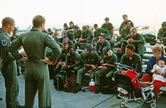 Members of the 428th Tactical Fighter Squadron listen as Captain (CPT) Kay Honea, the mobility officer in charge, briefs the personnel before entering the mobility line.  They are preparing for deployment to Ramstein Air Base, West Germany for the short-t