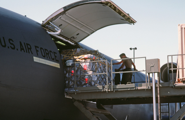 Supplies are loaded aboard a KC-10A Extender aircraft by a member of the 554th Combat Support Group.  The equipment and supplies are being transported to Ramstein Air Base, West Germany, for use in the short-term tactical deployment Exercise CRESTED CAP 8