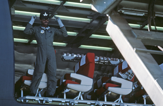 Technical Sergeant (TSGT) Jay Howell directs a K-loader into place while standing inside a KC-10A Extender aircraft.  The aircraft will be transporting equipment and supplies to Ramstein Air Base, West Germany, for use in the short-term tactical deploymen