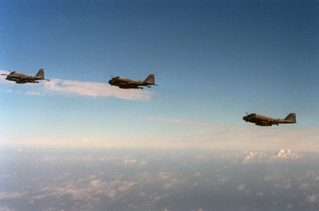 An air-to-air left side view of three Attack Squadron 176 (VA-176) A-6E Intruder aircraft during Exercise OCEAN SAFARI'87
