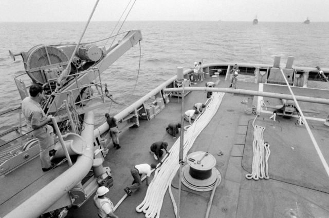 A view of the fantail of the salvage ship USS GRAPPLE (ARS 53) as seen from the ship's superstructure. The GRAPPLE is towing three minesweepers to the Persian Gulf to support US Navy escort operations