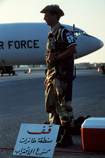 AIRMAN (AMN) Eric Roberts, 363rd Security Police Squadron, stands guard over the E-3A Sentry aircraft Airborne Warning and Control Squadron entry control point during Exercise SHADOW HAWK'87, a phase of BRIGHT STAR'87.  The US Central Command exercise rep