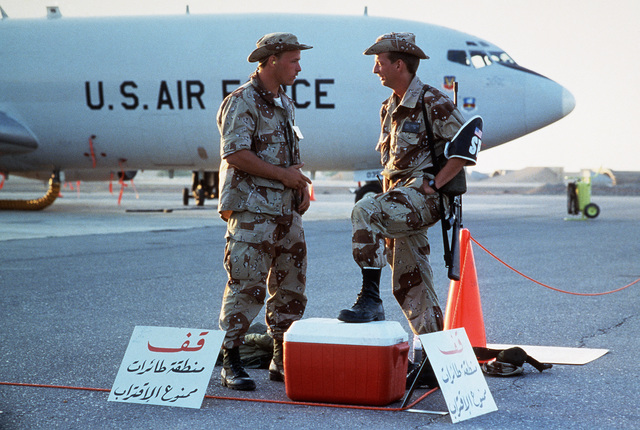 AIRMAN (AMN) Eric Roberts, 363rd Security Police Squadron, talks with AMN Michael Bailey from the 552nd Aircraft Generation Squadron while on sentry duty during Exercise SHADOW HAWK'87, a phase of BRIGHT STAR'87.  The US Central Command exercise represent