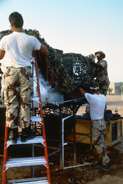 Airmen from the 4th Services Squadron remove camouflage netting as part of redeployment operations during Exercise SHADOW HAWK'87, a phase of BRIGHT STAR'87.  The US Central Command exercise represents a Joint Chiefs of STAFF effort to evaluate procedures