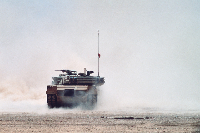 An M1A1 Abrams main battle tank fires its 120 mm main gun during Exercise SHADOW HAWK'87, a phase of Exercise BRIGHT STAR'87.  The exercise will evaluate procedures used to deploy US tactical and logistical forces