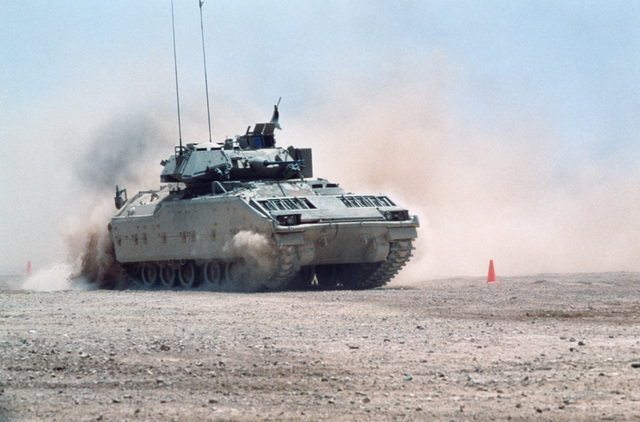 An M2 Bradley infantry fighting vehicle maneuvers in the desert during the capabilities exercise portion of Exercise SHADOW HAWK'87, a phase of Exercise BRIGHT STAR'87.  The exercise will evaluate procedures used to deploy US tactical and logistical forces