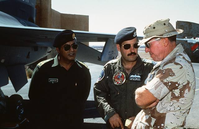 Brigadier General (BGEN) Robert C. Beyer, commander of US Central Command/Forward Headquarters, converses with Jordanian pilots on the flight line during Exercise SHADOW HAWK'87, a phase of BRIGHT STAR'87.  The US Central Command exercise represents a Joi