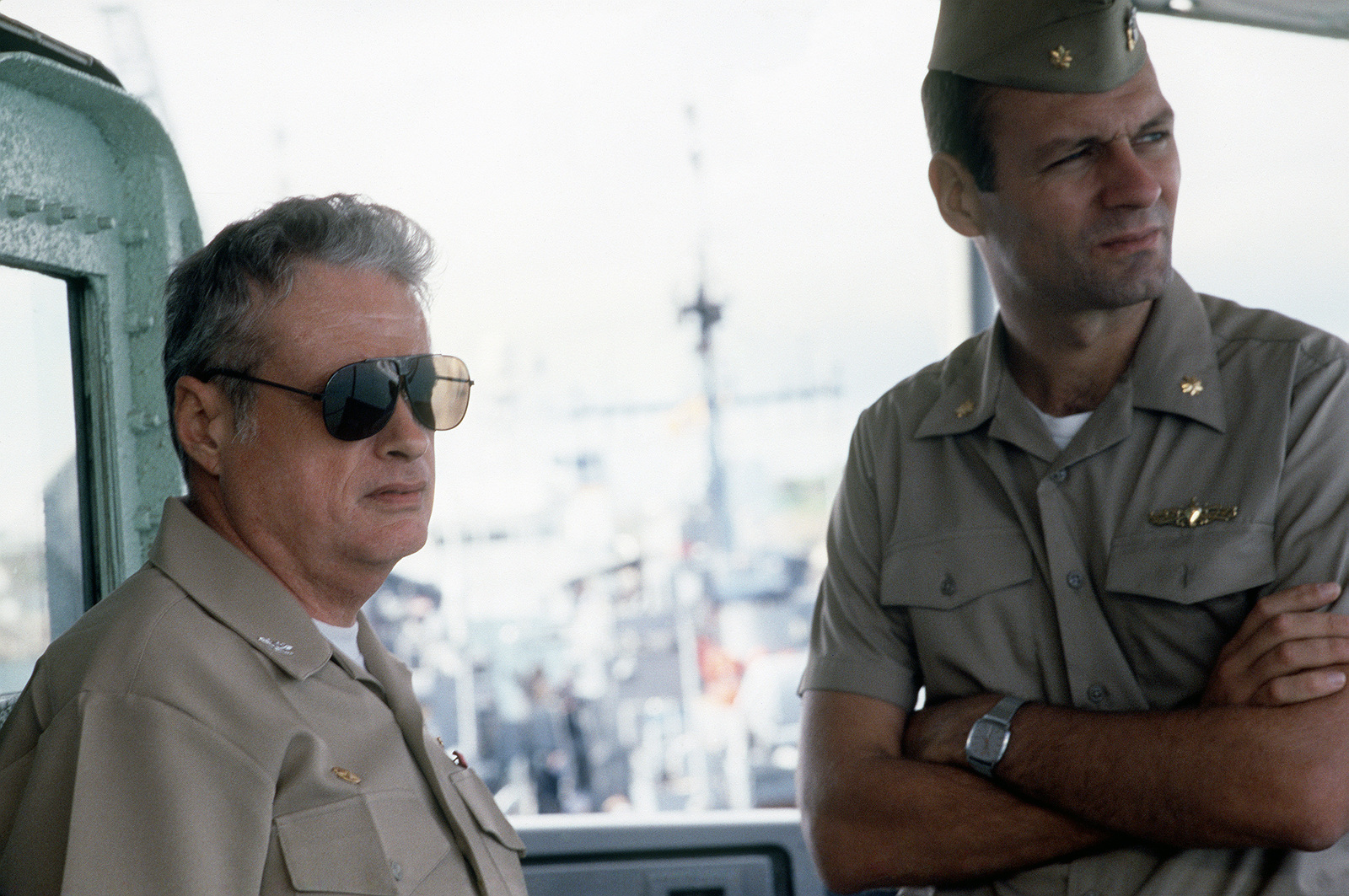 Captain (CAPT) Joseph Volpe and Lieutenant Commander (LCDR) William E. Jackson discuss towing operations being conducted by the salvage ship USS GRAPPLE (ARS 53). The GRAPPLE is towing three minesweepers to the Persian Gulf to support US Navy escort operations