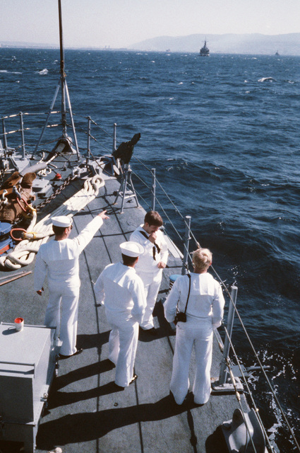 Crew members stand by on the bow as the ocean minesweeper USS FEARLESS (MSO 442) approaches port.  The FEARLESS is one of three minesweepers being towed to the Persian Gulf by the GRAPPLE to support US Navy escort operations
