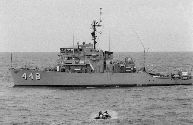 Divers in a inflatable boat head for the ocean minesweeper USS ILLUSIVE (MSO 448) for a survey dive. The ILLUSIVE is one of three minesweepers being towed to the Persian Gulf to support US Navy escort operations