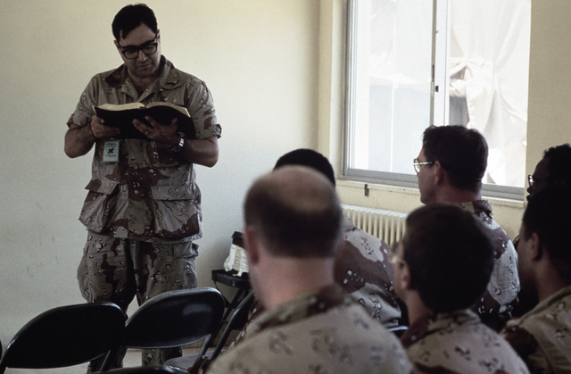 First Lieutenant (1LT) Virgil Hamaty of the 31st Combat Support Group reads from the Old Testament in a Protestant religious service during the Exercise SHADOW HAWK'87, segment of BRIGHT STAR'87.  In this US Central Command/Joint Chiefs of STAFF exercise,
