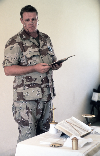 Lieutenant Colonel (LTC) James Mackey, USN, Chaplain reads from the Scriptures during Protestant religious services conducted for the Exercise SHADOW HAWK'87, segment of BRIGHT STAR'87.  In this US Central Command/Joint Chiefs of STAFF exercise, US forces