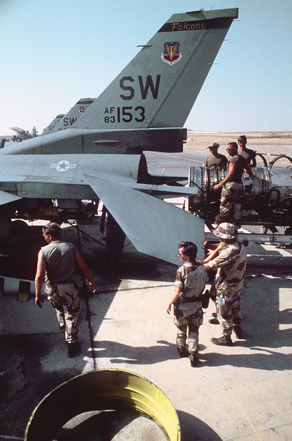 Major (MAJ) Joanne M. Rodrefer, maintenance officer, 33rd Aviation Maintenance Unit, reviews an engine change operation on the flight line during Exercise SHADOW HAWK'87, a phase of BRIGHT STAR'87.  The US Central Command exercise represents a Joint CHIEF