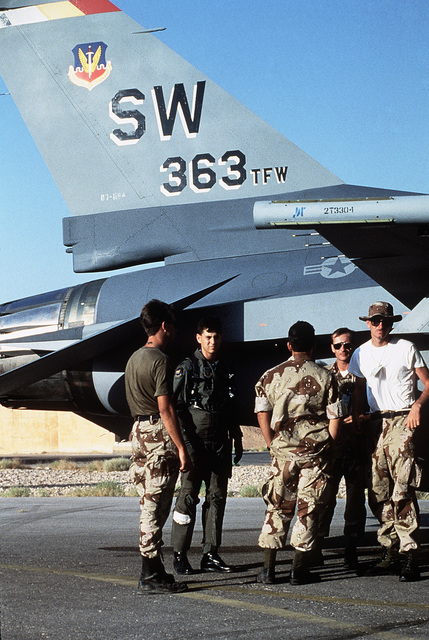 Members of the 33rd Aviation Maintenance Unit pose for a photograph following a foreign object damage (FOD) walk-down on the flight line during Exercise SHADOW HAWK'87, a phase of BRIGHT STAR'87.  The US Central Command exercise represents a Joint Chiefs