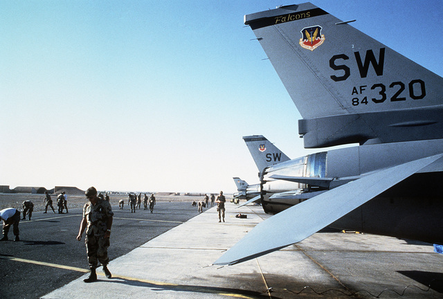Members of the 33rd Aviation Maintenance Unit take part in a foreign object damage (FOD) walk-down on the flight line during Exercise SHADOW HAWK'87, a phase of BRIGHT STAR'87.  The US Central Command exercise represents a Joint Chiefs of STAFF effort to