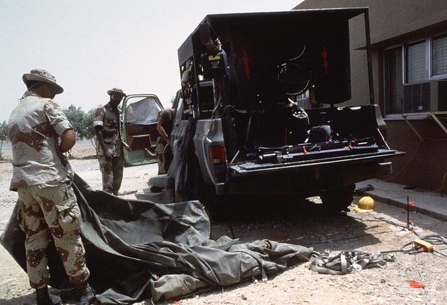 Members of the 3rd Combat Control Group pack equipment as their camp begins redeployment operations at the conclusion of Exercise SHADOW HAWK'87, a phase of BRIGHT STAR'87.  The US Central Command exercise represents a Joint Chiefs of STAFF effort to eval