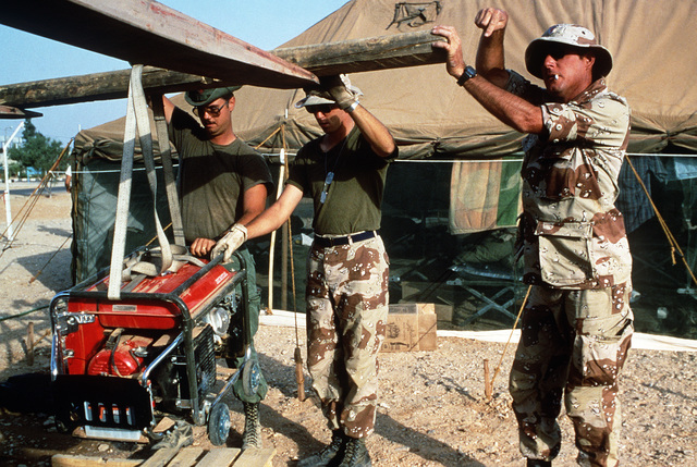 Members of the 4th Services Squadron tear down tents for redeployment at the conclusion of Exercise SHADOW HAWK'87, a phase of BRIGHT STAR'87.  The US Central Command exercise represents a Joint Chiefs of STAFF effort to evaluate procedures used to deploy