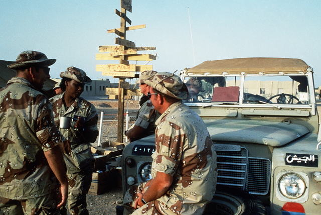 Members of the crash rescue team and the fire rescue team enjoy a cup of coffee before moving out to the flight line during Exercise SHADOW HAWK'87, a phase of BRIGHT STAR'87.  The US Central Command exercise represents a Joint Chiefs of STAFF effort to e