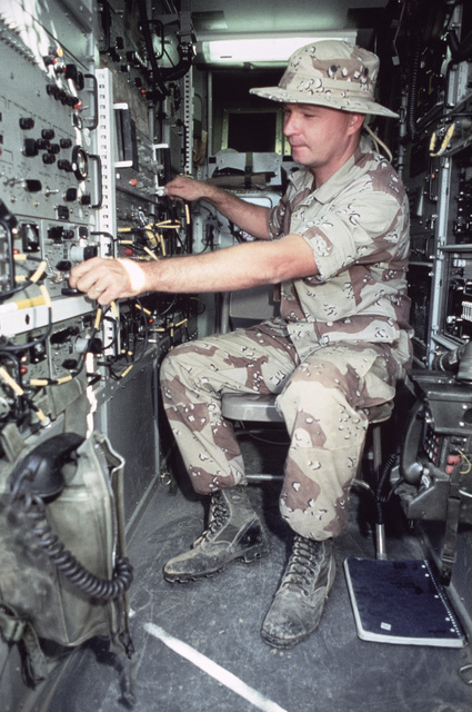 Navy Electronics Technician Third Class (ET3) Richard M. Martinez, a member of the Joint Communications Support Element, works on a high frequency satellite dish during Exercise SHADOW HAWK'87, a phase of BRIGHT STAR'87.  The US Central Command/Joint Chie
