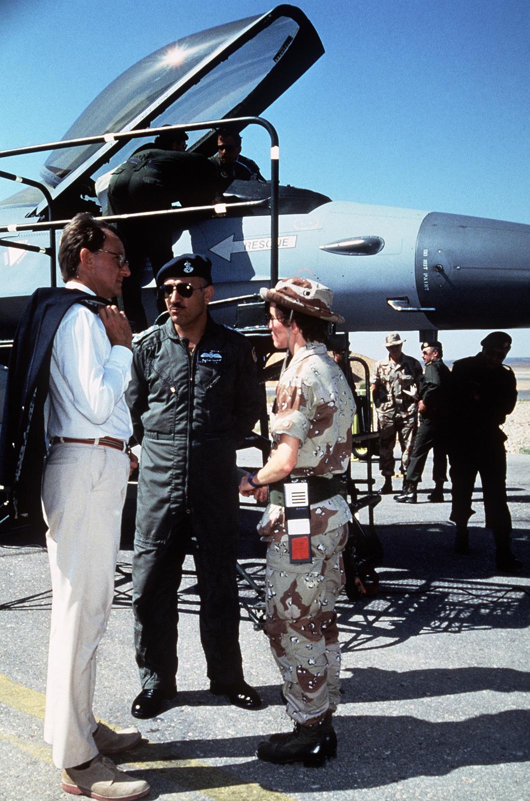 Paul Boeker, US ambassador to Jordan, talks with a member of