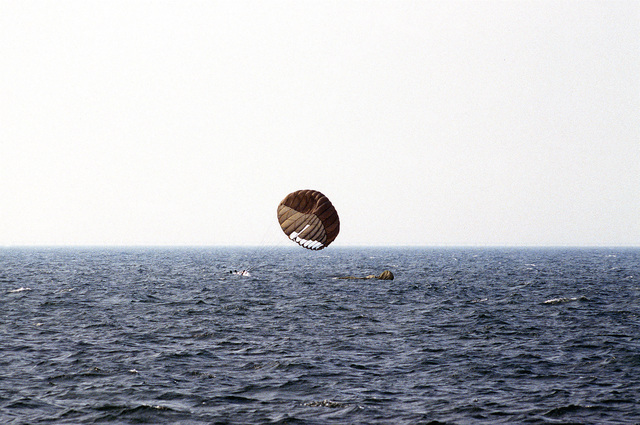 Sea-Air-Land (SEAL) team members parachute into the sea during a training exercise