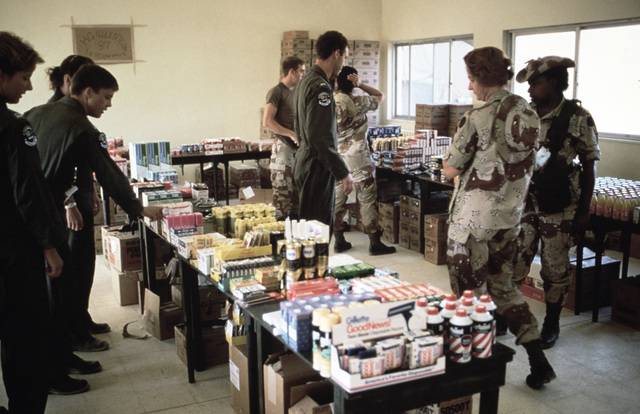 Servicemen shop at the Tactical Field Exchange set up for the Exercise SHADOW HAWK'87, segment of BRIGHT STAR'87.  Products for the base exchange of the US Central Command/Joint Chiefs of STAFF exercise with the Jordanian military were provided by the Air