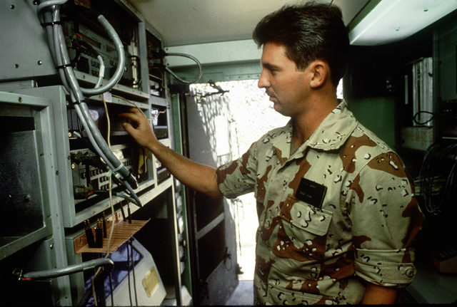 STAFF Sergeant Rick Gray logs in weather reports at the control panel of the U.S. Central Command weather trailer being used in Shadow Hawk, a joint Jordan/U.S. exercise within exercise Bright Star '87. Shadow Hawk is a combined effort of the U.S. Central