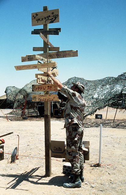 STAFF Sergeant (SSGT) Jeffrey Blevings, 4th Services Squadron, constructs a home town sign at camp during Exercise SHADOW HAWK'87, a phase of BRIGHT STAR'87.  The US Central Command exercise represents a Joint Chiefs of STAFF effort to evaluate procedures