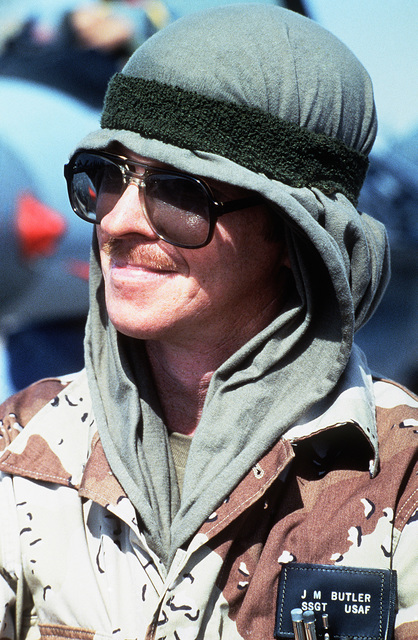 STAFF Sergeant (SSGT) Mack Butler, 33rd Aviation Maintenance Unit, wears a shirt on his head to combat the heat as he works on the flight line during Exercise SHADOW HAWK'87, a phase of BRIGHT STAR'87.  The US Central Command exercise represents a Joint C