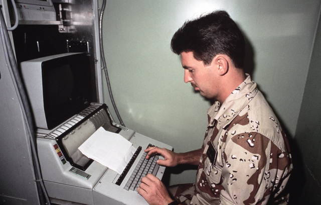 STAFF Sergeant (SSGT) Rick E. Gray, Joint Communications Support Element, uses a teletype machine to transmit weather information during Exercise SHADOW HAWK'87, a phase of BRIGHT STAR'87.  The US Central Command/Joint Chiefs of STAFF exercise provides US