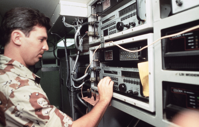 STAFF Sergeant (SSGT) Rick Gray logs in weather reports at the control panel of the US Central Command weather trailer being used in Exercise SHADOW HAWK'87, a joint Jordan/US Exercise within Exercise BRIGHT STAR'87.  SHADOW HAWK is a combined effort of t