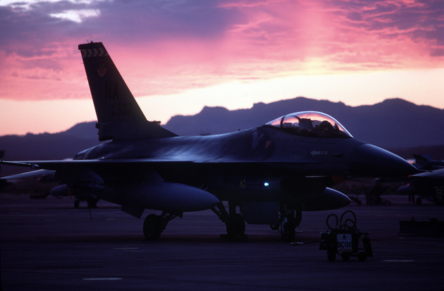 An F-16B Fighting Falcon aircraft from the 430th Tactical Fighter Squadron (TFS) is marshalled out in predawn hours for a flight to El Libertador Air Base, Venezuela.  Aircraft and personnel of the 430th TFS are deploying for a two-week training exercise with members of Group 16 of the Venezuelan air force