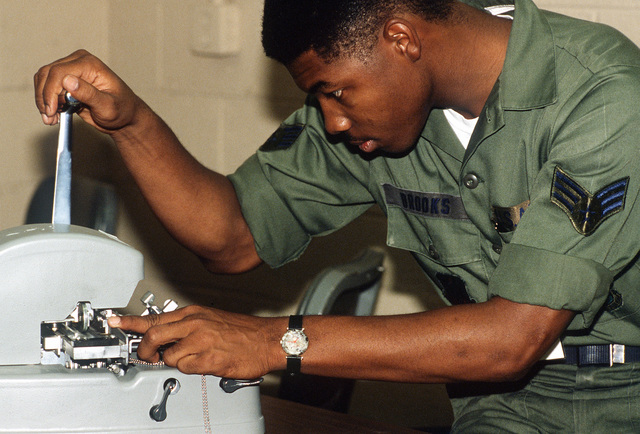 SGT Brooks makes identification tags for members of the 430th Tactical Fighter Squadron prior to their deployment to El Libertador Air Base, Venezuela, for a two-week training exercise with members of Group 16 of the Venezuelan air force