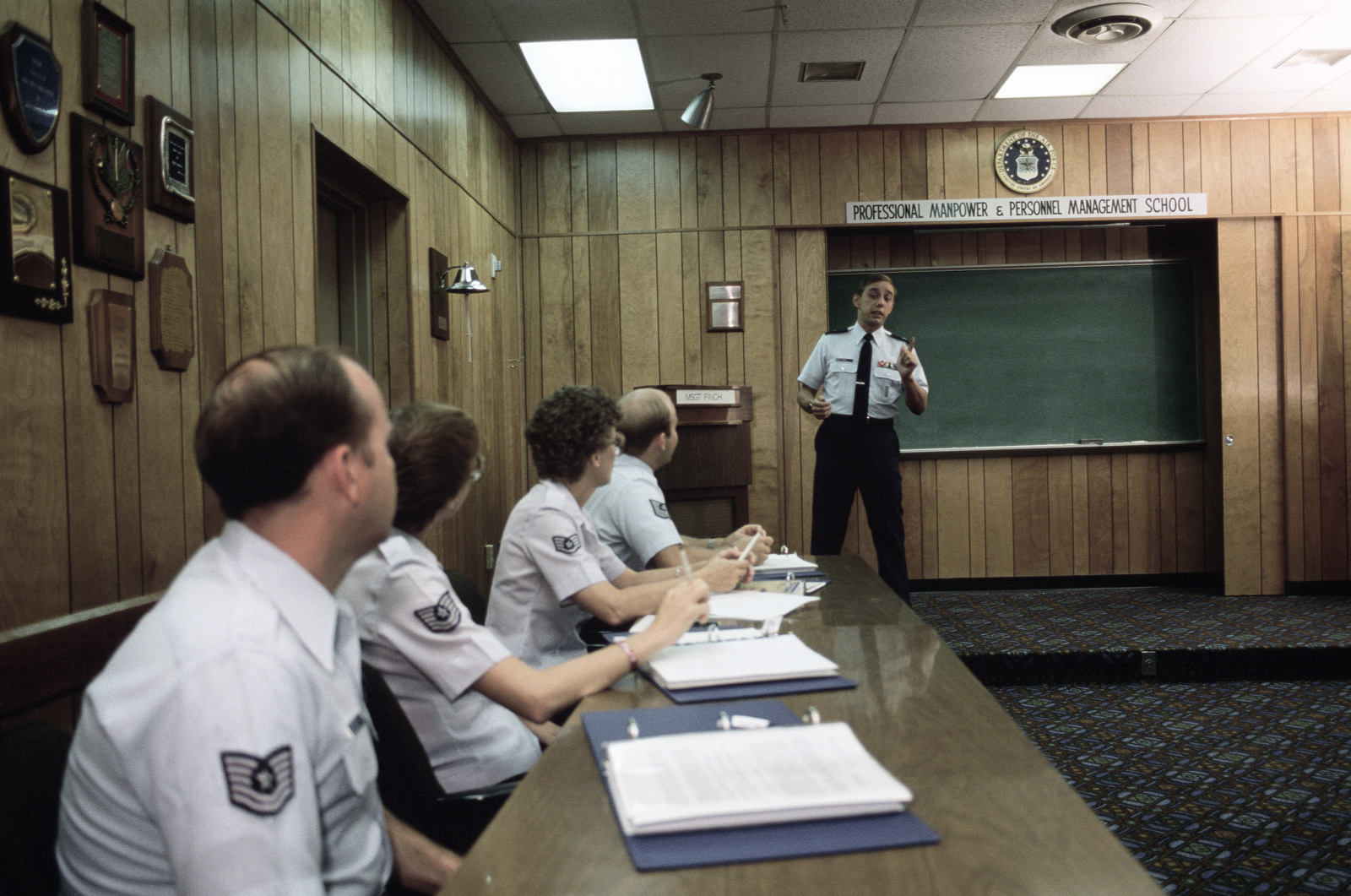 An instructor teaches public speaking to students at Air University.  The university offers formal training in many areas of military studies to officers and senior non-commissioned officers in the Air Force