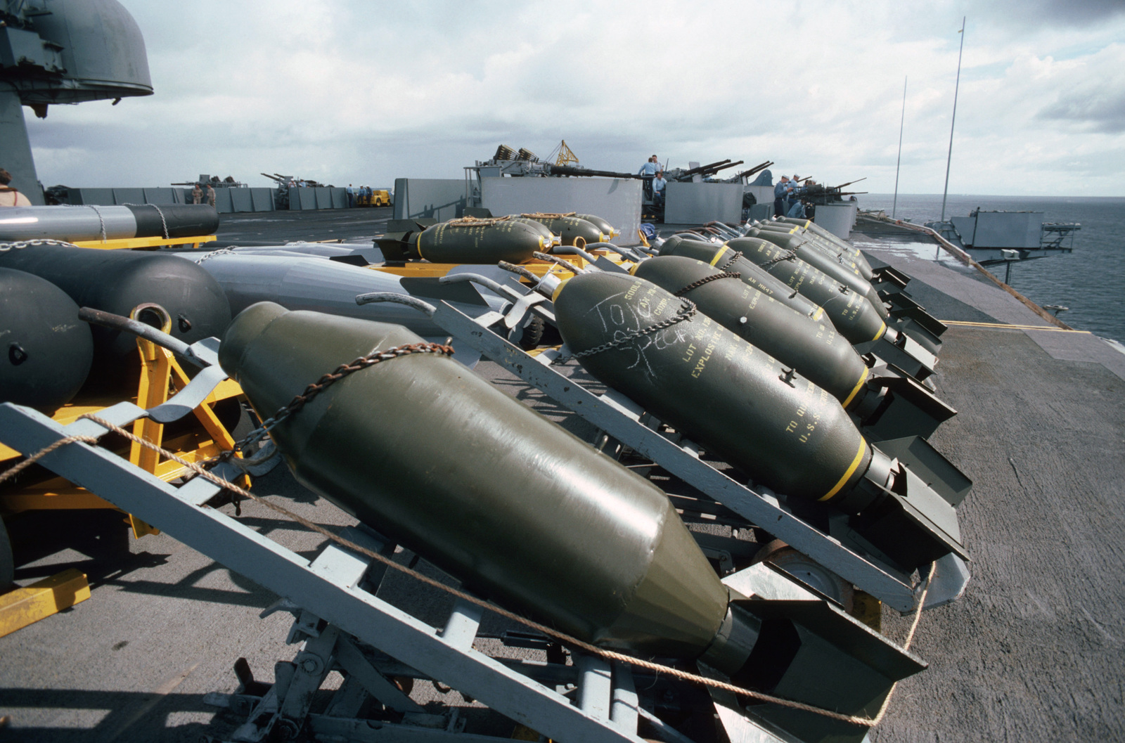 A line of World War II-era bombs are staged on the flight