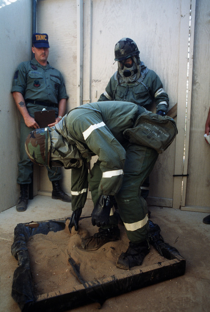A team member wears chemical protective gear as he decontaminates himself during the individual decontamination portion of the Tactical Air Command's (TAC) Prime Beef Challenge.  Prime Beef Challenge is a series of timed events to determine which unit wil