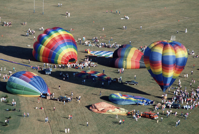 """Hot-air balloons are prepared for flight during the""""Festival of Flight,""""an Air Force 40th anniversary celebration"""